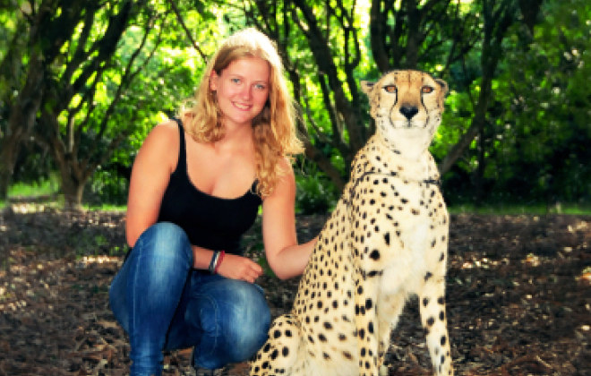 Visitor posing with a cheetah.
