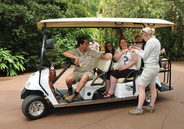 Golf cart with visitors on board.
