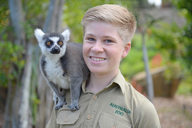 Robert Irwin with Vatobe the Ring Tailed Lemur on his shoulder.