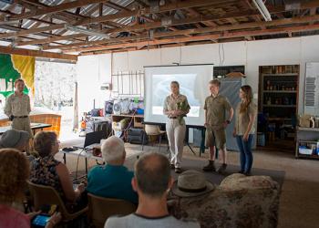 Terri, Robert, and Bindi in a classroom.