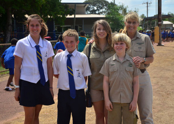 Irwin family visiting a school.