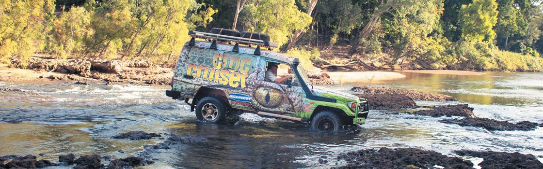 Expedition van going through a river.
