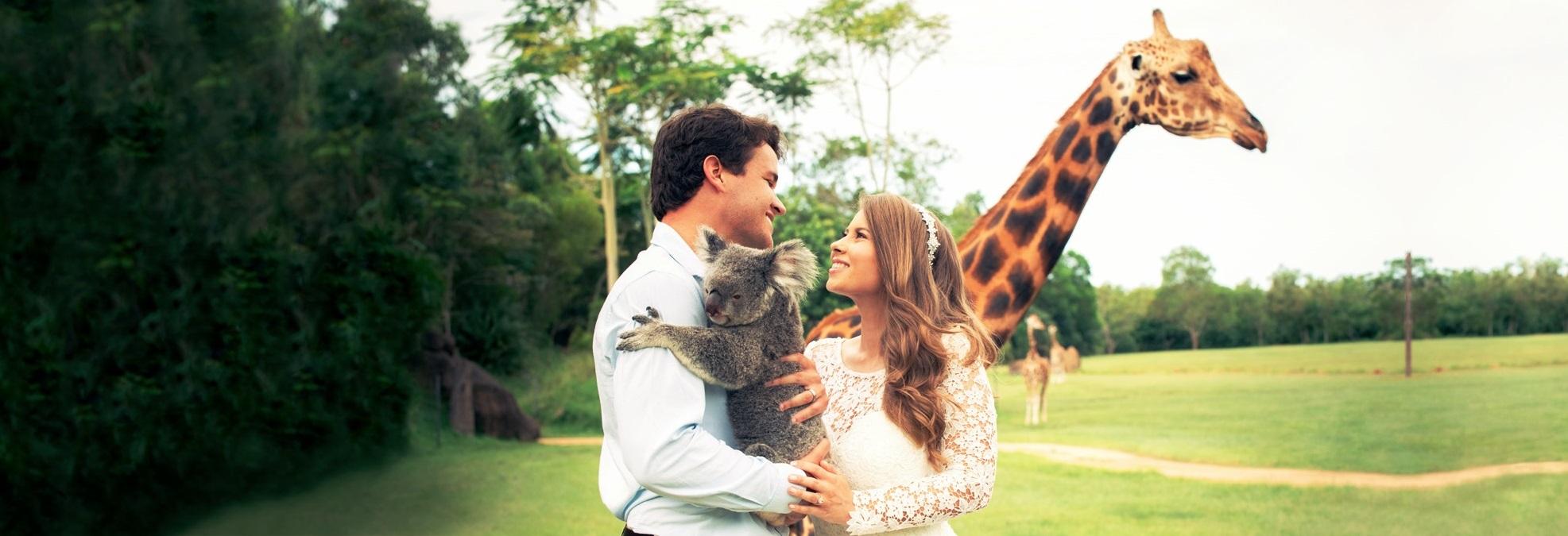 Bindi Irwin and Chandler Power with Koala and Giraffe