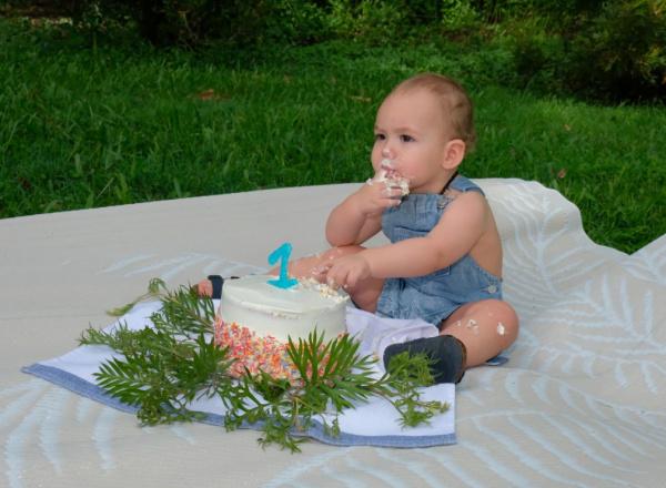 cake smash baby eating cake